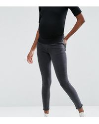 ASOS Ridley Skinny Jean In Washed Black With Zip Hem With Under The Bump Waistband