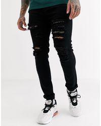 Liquor N Poker – Enge Jeans mit Rissen - Schwarz