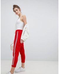 Bershka - Wide Side Stripe Peg Leg In Red - Lyst