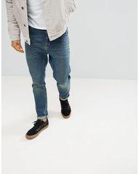 ASOS – Schmal zulaufende Jeans - Blau