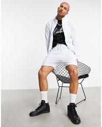 The Couture Club X Ellesse Carlos Logo Shorts - Blue