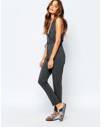 Stitch & Pieces - Titch & Pieces Wrap Front Jumpsuit - Lyst