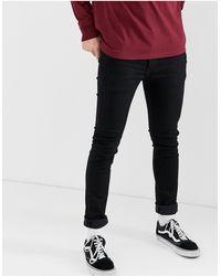 Levi's 519 – Extem enge Jeans mit niedrigem Bund - Schwarz