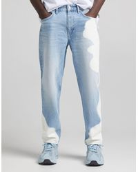 Bershka 90s Fit Jeans With Bleach Out Patches - Blue