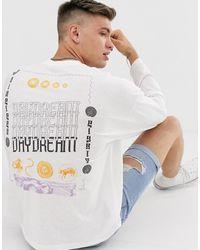 ASOS T-shirt oversize à manches longues avec imprimé Daydream au dos - Blanc