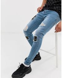SIKSILK Super Skinny Jeans With Baroque Rips - Blue