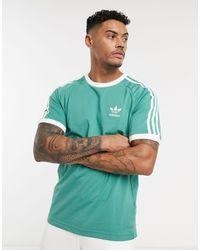 adidas Originals – California – T-Shirt - Grün