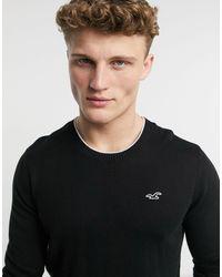 Hollister Jersey con cuello redondo y logo - Negro
