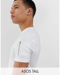 ASOS Tall - T-shirt skinny lunga con fondo arrotondato e tasca stile MA1 bianca - Bianco