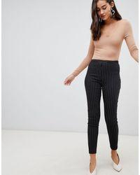 New Look Pantalon slim à fines rayures - Noir