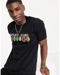 Versace Jeans Couture T-shirt nera con logo con charms - Nero