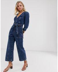 & Other Stories Blauer Jeans-Jumpsuit mit tiefem V-Ausschnitt und Taillenschnürung