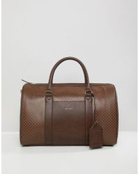 ASOS Carryall In Brown Print With luggage Tag