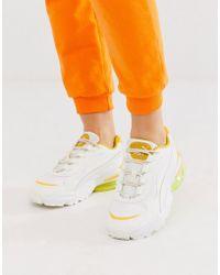 PUMA Cell Stellar - Sneaker in Weiß mit Gelb