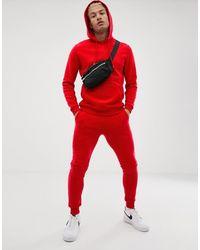ASOS Survêtement - Hoodie et joggers ajusté - Rouge