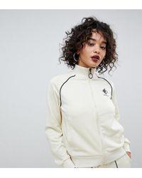 Fila Trainingsjacke aus Rippstrick mit Logo auf der Vorderseite und kontrastierender Paspelierung - Weiß