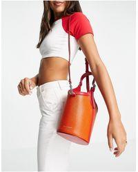 Rebecca Minkoff - Borsa a secchiello arancione con manico - Lyst