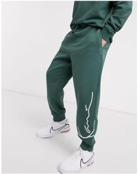 Karlkani Joggers verdes con diseño