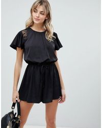 6190ed8104 Missguided Strappy Lace Insert Playsuit Black in Black - Lyst
