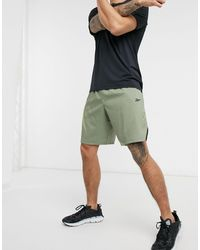 Reebok Training - Pantaloncini kaki con stampa - Verde
