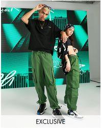 Collusion Unisex - Pantaloni multitasche larghi a vita bassa kaki - Verde