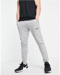 Nike - Dri-fit Tapered joggers - Lyst