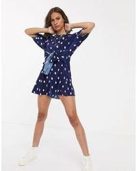 ASOS Plisse Knot Front Short Sleeve Playsuit In Navy Spot Print - Blue
