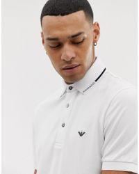 Emporio Armani Polo slim à liseré contrastant et logo - Blanc