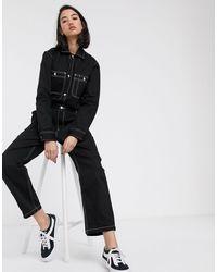 Carhartt WIP Combinaison décontractée en jean avec coutures contrastantes - Noir