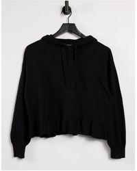 Vero Moda Sudadera negra con capucha y ribetes con volantes - Negro