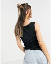 Oasis Top negro estilo camisola con ribetes