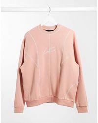 The Couture Club Sweat-shirt oversize à empiècements - Rose