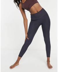 Onzie - – Yoga-7/8-Leggings mit hohem Bund und linearem Muster - Lyst