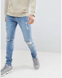 Criminal Damage Skinny Jeans In Blue