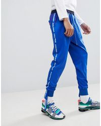 D-ANTIDOTE X Fila Sweatpants With Taping - Blue
