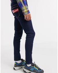 Love Moschino Jean skinny avec logo au dos - Bleu