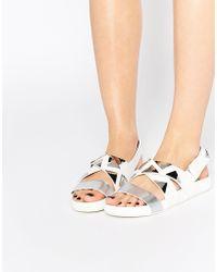 E8 - West Triangle Stud Flat Sandals - Lyst