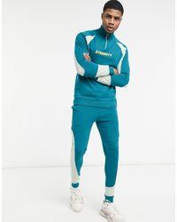 ASOS Tuta sportiva con zip corta, pannelli color block e stampa sul petto - Verde