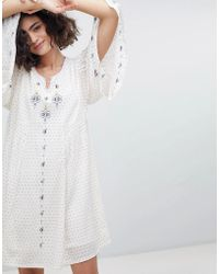 INTROPIA - Embroidered Tunic Dress With Fluted Sleeve - Lyst