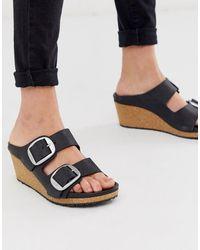 Birkenstock Nora Big Buckle Wedge Sandals In Black