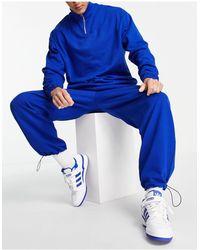 ASOS Tuta sportiva con felpa con zip corta e joggers super oversize con fermacorda sul fondo blu