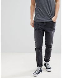 ASOS Asos Tapered Jeans In Washed Black With Faux Leather Rip & Repair