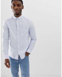 Calvin Klein - Camisa Oxford a rayas con diseño abotonado - Lyst