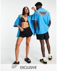 Reclaimed (vintage) Camisa unisex con estampado - Azul