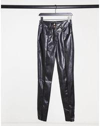 Girl In Mind Pantalones negros con abertura en la parte delantera