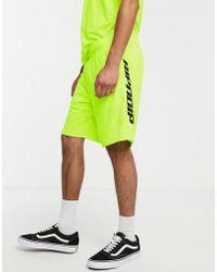 RIPNDIP Pantalones cortos de fútbol verde neón a rayas MBN