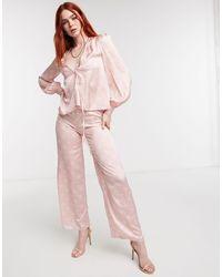 Never Fully Dressed Pantalon d'ensemble large en satin à imprimé mosaïque ton sur ton - Rose