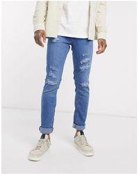 Jack & Jones Intelligence – Schmale zulaufende Jeans mit Zierrissen - Blau