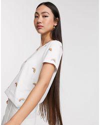 ONLY – Kita – T-Shirt mit Regenbogendesign - Weiß