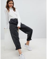 ASOS Tapered Boyfriend Jeans With Curved Seams And Belt - Black